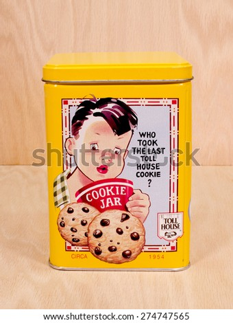 RIVER FALLS,WISCONSIN-MAY 01,2015: A vintage Nestles Toll House cookie tin. This tin was originally made around Nineteen Fifty Four. - stock photo