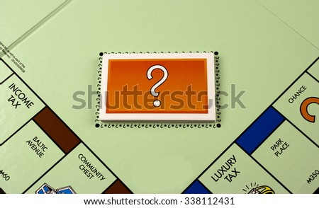 RIVER FALLS,WISCONSIN-NOVEMBER 11,2015: A Monopoly board featuring the Chance cards. Monopoly originated in the United States in Nineteen Hundred and Three. - stock photo