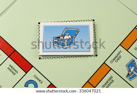 RIVER FALLS,WISCONSIN-NOVEMBER 06,2015: A Monopoly board featuring the Community Chest cards. Monopoly originated in the United States in Nineteen Hundred and Three. - stock photo