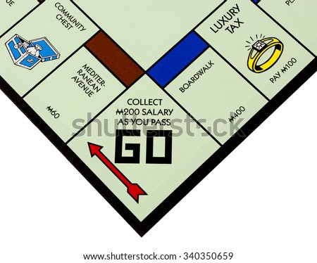 RIVER FALLS,WISCONSIN-NOVEMBER 17,2015: A Monopoly board featuring the Go square. Monopoly originated in the United States in Nineteen Hundred and Three. - stock photo