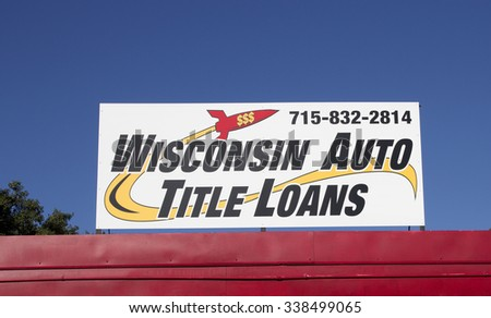 RIVER FALLS,WISCONSIN-NOVEMBER 12,2015: A Wisconsin Auto title loans sign against a blue sky. - stock photo