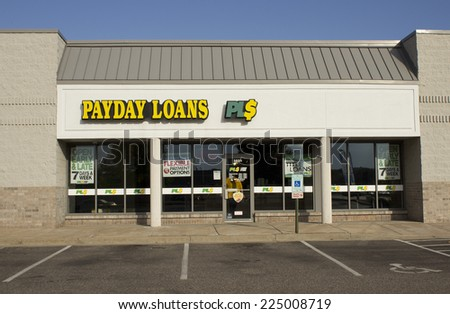 RIVER FALLS,WISCONSIN-OCTOBER 20,2014: Payday Loans retail storefront. Payday Loan LLC is headquartered in Anaheim,California. - stock photo