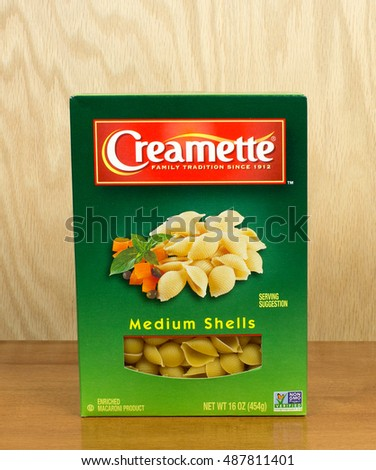 RIVER FALLS,WISCONSIN-SEPTEMBER 23,2016: A box of Creamette brand medium shell pasta with a wood background.