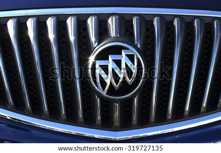 RIVER FALLS,WISCONSIN-SEPTEMBER 23,2015: A closeup view of the Buick Automotive emblem. Buick is currently the oldest North American auto maker. - stock photo
