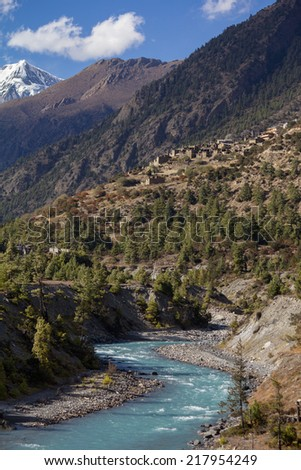 River flowing down from mountains through village of lower pisang - stock photo