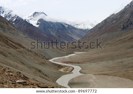 river flowing in the mountains - stock photo
