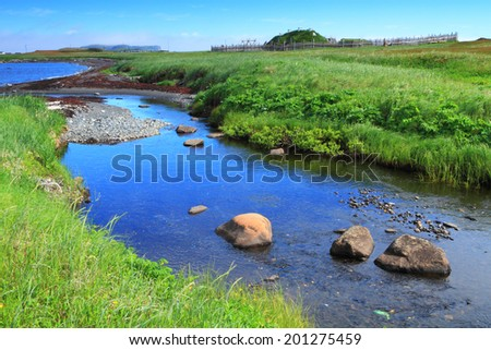 River flowing through ancient homes of Viking settlers in L'Anse aux Meadows national historic site, Newfoundland, Canada - stock photo