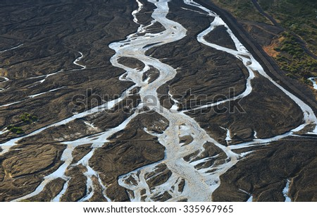 River flowing through the volcanic landscape of Iceland. - stock photo