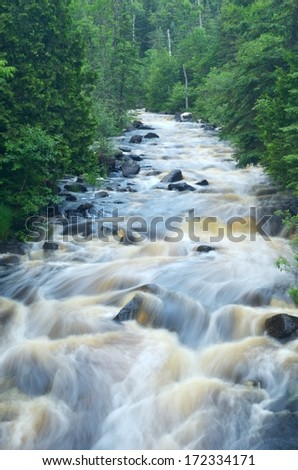 River Flowing Through the Woods in Northern Minnesota, East Branch of the Baptism River - stock photo