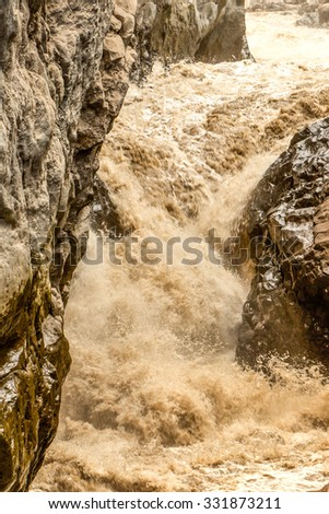 River Full With Volcanic Ash After The Explosion Of Tungurahua Volcano Ecuador - stock photo