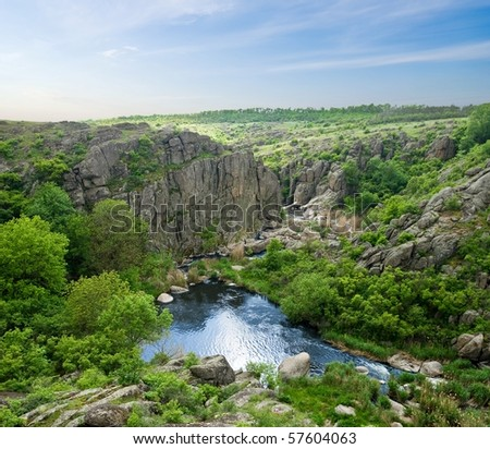 river in a canyon - stock photo