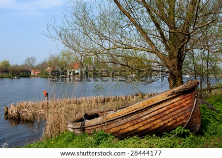 River in Holland with wooden sloop