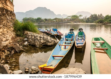 River in Laos.Vang Vieng Landscape.Boat park at riverside. - stock photo