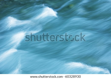 river in motion nature background - stock photo