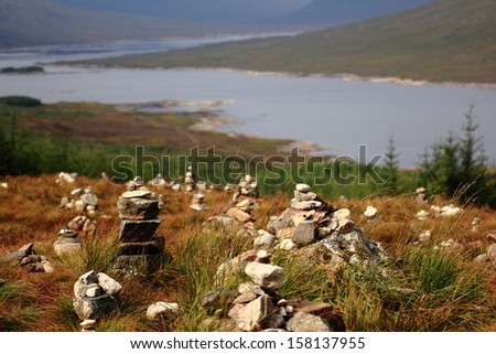 River in scotland with stone's monuments. - stock photo