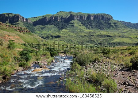 River in the foothills of the Drakensberg Mountains, KwaZulu-Natal, South Africa  - stock photo
