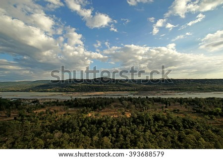 river in wild with beautiful cloud sky background
