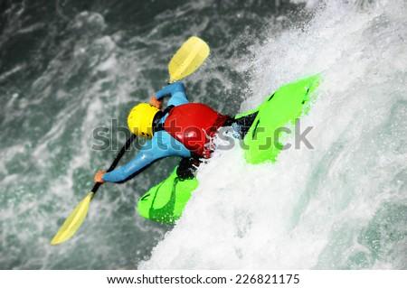 River Kayaking, extreme waterfall - stock photo