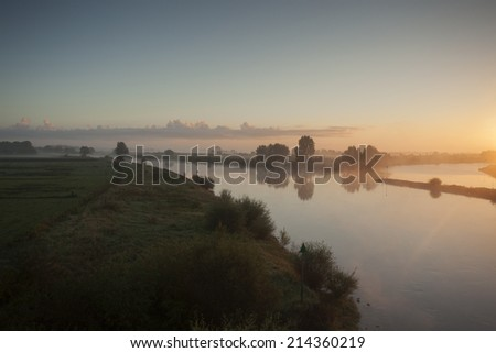 River landscape at daybreak seen from above - stock photo