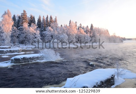 River landscape in a very cold morning at sunrise