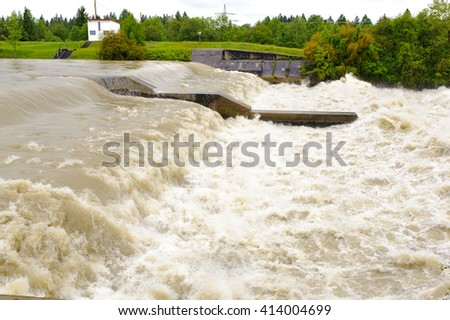 river Lech in Bavaria with big flood at weir - stock photo