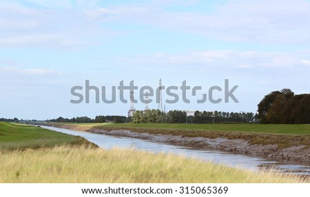 River Nene at low tide at Foul Anchor, Cambridgeshire. Sutton Bridge and the local power station are seen in the distance.