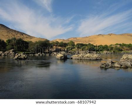 River Nile with dunes near Aswan (Egypt) - stock photo
