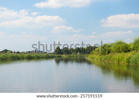 River old IJssel in Dutch landscape - stock photo