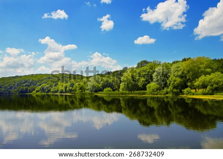 river on background of trees and sky
