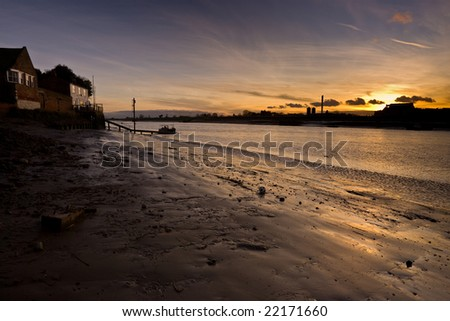 River Ouse at Kings Lynn UK passenger ferry and sunset - stock photo