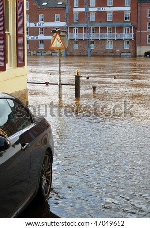 River Ouse flood waters reach parked car in York street. North Yorkshire, UK. - stock photo