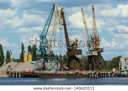 River port, a jetty for the shipment of macadam - stock photo