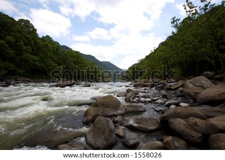 River Rapids & Senic View of Bridge - stock photo