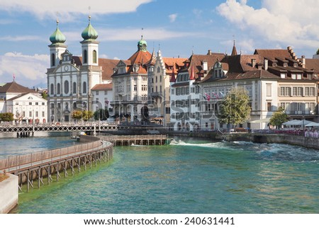 River Reuss and the Jesuits church in Lucerne, Switzerland. - stock photo