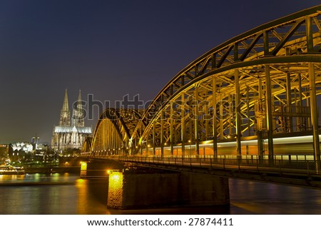 River Rhine, Bridge and Cologne Cathedral in Germany at Night - stock photo