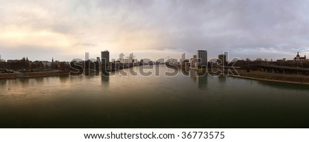 River Rhine (Rhein) between the german cities Mannheim (right) and Ludwigshafen (left) - stock photo