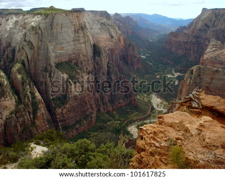 River running through a lush, rocky canyon in Utah - stock photo