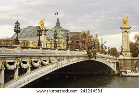 River Seine and the famous bridge  Alexandre III. - stock photo