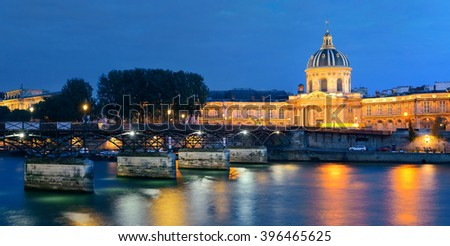 River Seine with Pont des Arts and Institut de France panorama at night in Paris, France. - stock photo