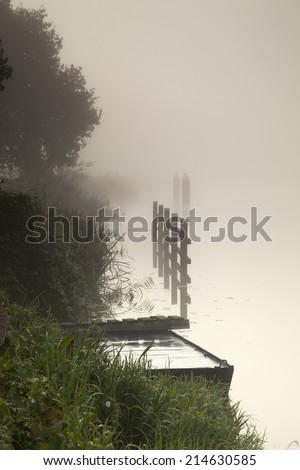 River shore in the mist - stock photo