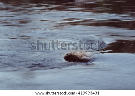 River side. Current between the stones of the river, blurred by a slow shutter speed. Crear stone river. - stock photo