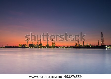 river side oil refinery industry plant along twilight morning,beautiful  sky