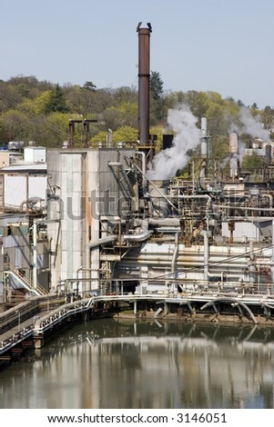 River side paper mill site - stock photo