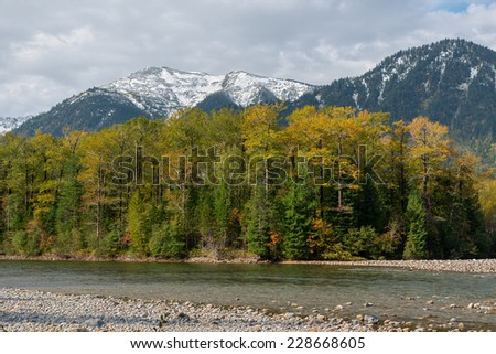 "River ""Snowy"" and the Khamar-Daban in Eastern Siberia in the autumn"