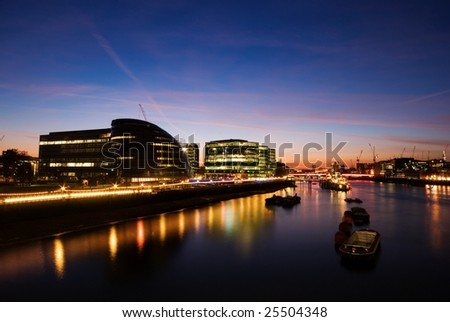 River Thames and the City of London at sunset. - stock photo