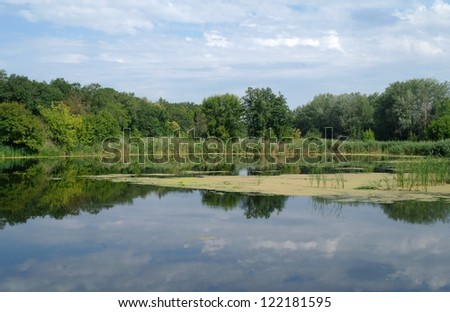 river, trees and cloudy sky - stock photo