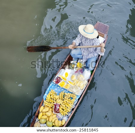 River vendor selling fruits at floating market in Bangkok - stock photo