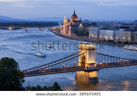 River view of Budapest at twilight, illuminated Chain Bridge over Danube River and Hungarian Parliament