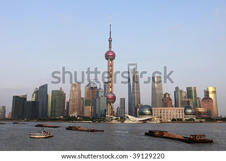 River View of the Skyline of the Pudong Area, Shanghai, China. Many elements of construction materials and cranes visible. - stock photo