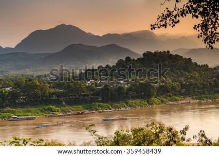 River view of world heritage site, Luang Prabang, Laos. - stock photo